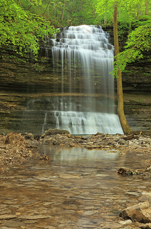 Springtime at Stillhouse Hollow Falls in Maury County, Tennessee; this was captured May 5, days after the Big Flood of May, 2010. The swollen creek cut a new channel from the base pool, uncovering rocks that hadn't seen the light of day in years...